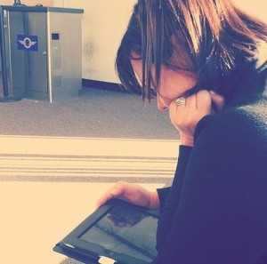 woman reading on tablet